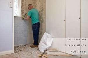 Handyman working on bathroom renovation