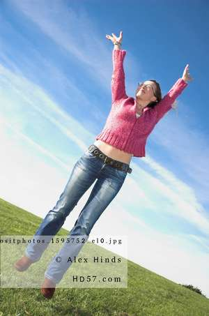 Happy woman leaping in air